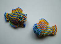 Lynn Davy Beading. Reef Fish.  Peyote stitched tropical fish from a design by Vivien Caldwell. Each of these tiny beauties takes over an hour to make, even with a pattern to follow.