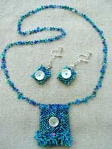 Lynn Davy beading, Mermaid's Purse, a right-angle weave and peyote amulet bag.  Tiny shell sequins that decorate the front of this reversible amulet bag. The matching earrings are also reversible