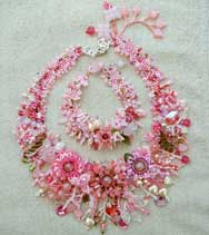 Lynn Davy Beading Rose Garden collar, Peyote collar covered with beaded flowers and embellished with branched fringe. Swarovski crystals form one of the many flowers that encrust this gorgeous necklace.  Instructions for this were published in Bead magazine in December 2006, so you can make your own; all feedback and/or pictures will be very welcome!