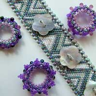 Lynn Davy Beading - Beading Gallery - Photography by Joanna Bury. Corona Cuff  A peyote stitch design with 'corona' embellishments that fit over buttons, so the whole appearance of the bracelet can be changed whenever you like. I'll be teaching this as a workshop at Stitch'n'Craft in the autumn 2008; check their website for details.  click on thumbnail to see larger image