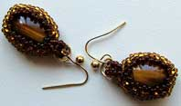 Lynn Davy Beading - Beading Gallery - Photography by Joanna Bury. Tigereye earrings  Silky smooth tigereye cabochons in tiny seed beaded bezel settings; a proposed new kit design for Westcoast Jewellery   click on thumbnail to see larger image